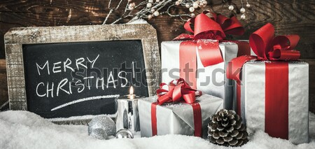 Crop of Christmas gifts Stock photo © vwalakte
