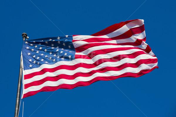 Amerikai zászló kék ég USA különleges háttér hullám Stock fotó © vwalakte