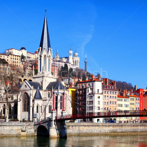 Lyon cityscape from Saone river with footbridge Stock photo © vwalakte