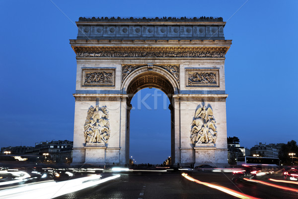 The famous Arc de Triomphe by night Stock photo © vwalakte