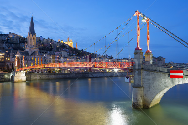 Lyon with Saone river and footbridge at night Stock photo © vwalakte