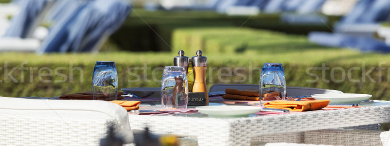 Crop of restaurant table on resort Stock photo © vwalakte