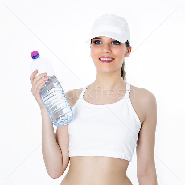 Wody sportu kobieta butelki uśmiech szczęśliwy Zdjęcia stock © vwalakte