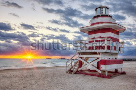 sunrise with famous lifeguard tower Stock photo © vwalakte