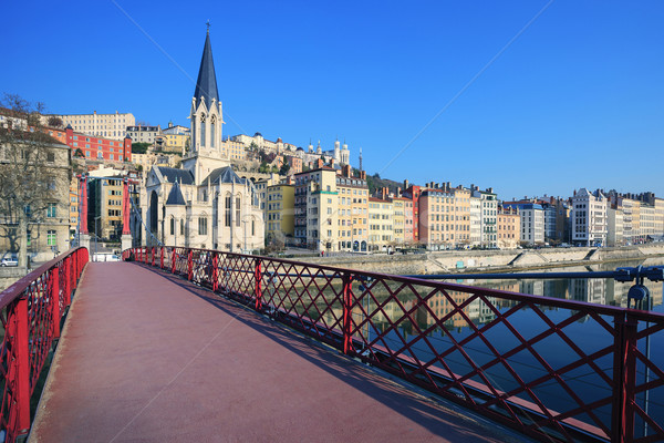 Famous view of Saone river and red footbridge in Lyon city Stock photo © vwalakte