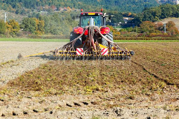 Nehéz traktor mezőgazdaság mező eke technológia Stock fotó © vwalakte