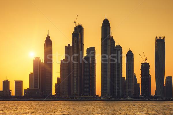мнение Дубай солнце Восход дома город Сток-фото © vwalakte