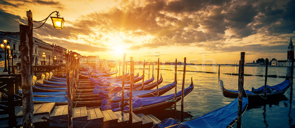 Panoramic view of Venice with gondolas at sunrise Stock photo © vwalakte