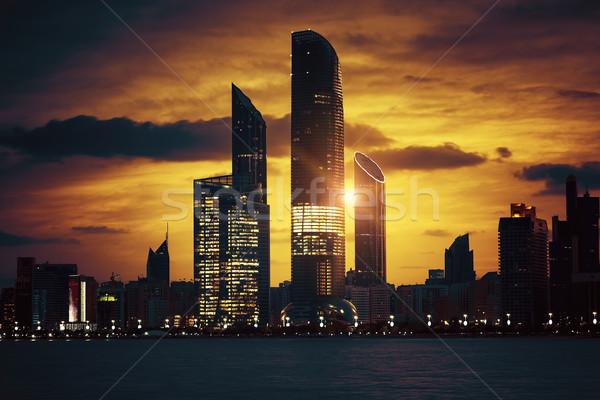 сверхъестественный закат мнение Абу-Даби Skyline Объединенные Арабские Эмираты Сток-фото © vwalakte