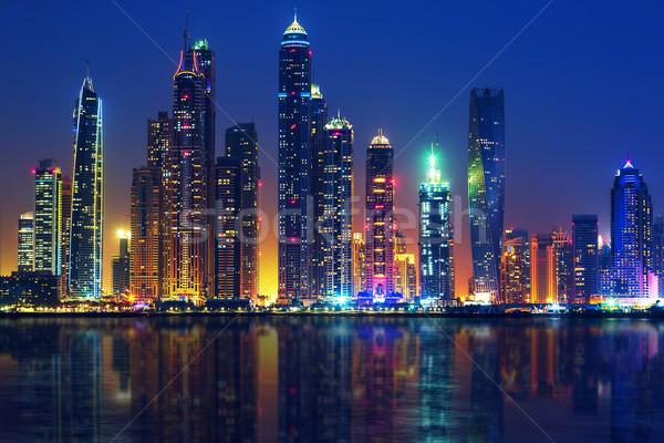 Kilátás Dubai éjszaka város építkezés technológia Stock fotó © vwalakte