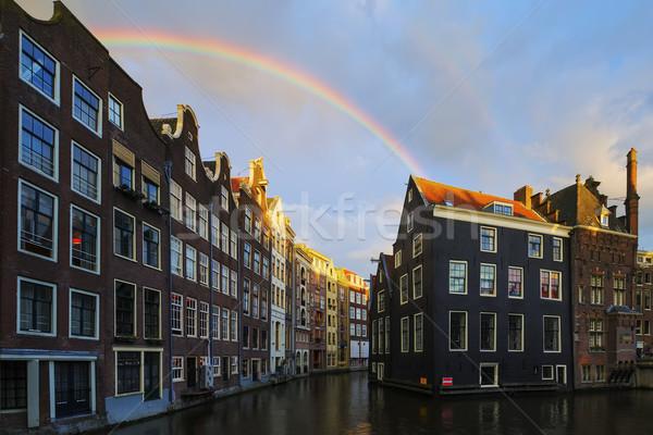 Amsterdam kanaal regenboog Nederland huis straat Stockfoto © vwalakte