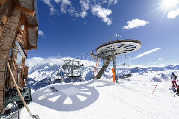 Ski chair-lift arrival in alpine mountain  Stock photo © vwalakte