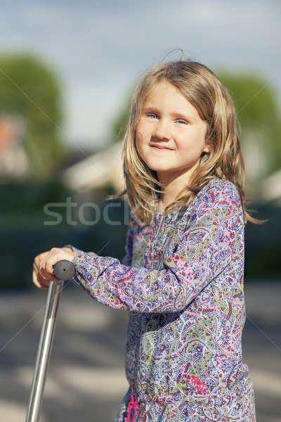 Little girl ride the scooter Stock photo © vwalakte
