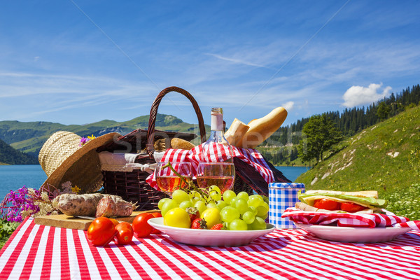 Picnic in french alpine mountains with lake  Stock photo © vwalakte