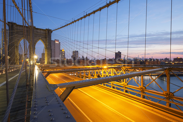Brooklyn Bridge at sunrise. Stock photo © vwalakte