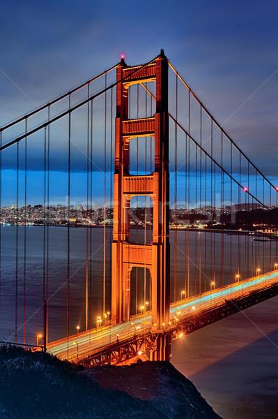 Famoso Golden Gate Bridge noche San Francisco luces puesta de sol Foto stock © vwalakte