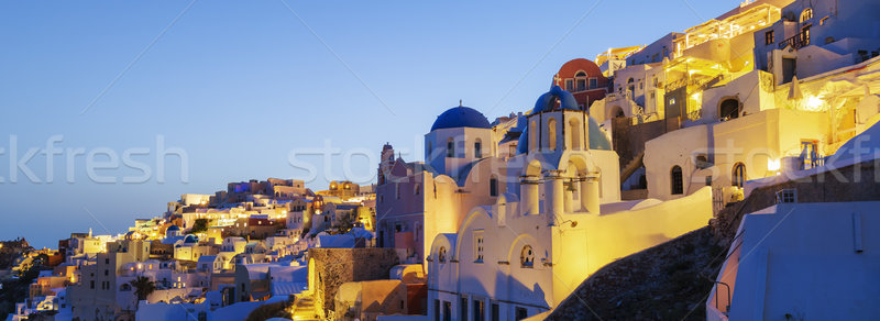 Panoramic view of Oia village at night Stock photo © vwalakte