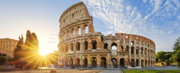 Colosseum Róma reggel nap Olaszország panorámakép Stock fotó © vwalakte