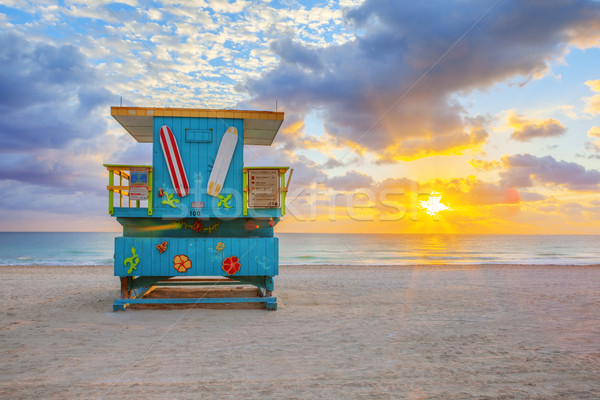 sunrise with cute lifeguard tower Stock photo © vwalakte