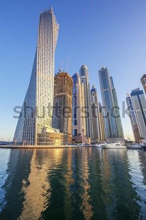 Függőleges kilátás felhőkarcolók Dubai marina víz Stock fotó © vwalakte