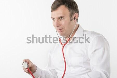 Man is holding stethoscope Stock photo © w20er