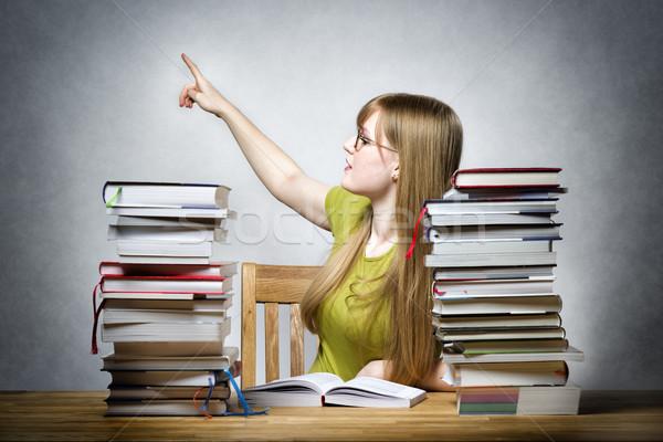 Female teacher pointing back Stock photo © w20er
