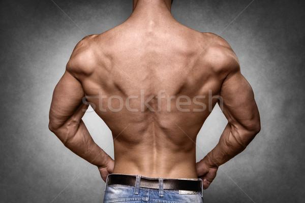 Athlete in denim trousers Stock photo © w20er