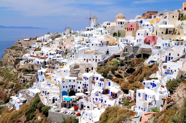 Windmile and houses of Oia on Santorin island Stock photo © w20er