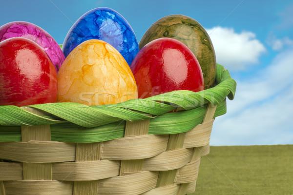 Színes húsvéti tojás kosár kék ég fehér felhők Stock fotó © w20er