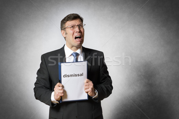 Business man with dismissal Stock photo © w20er