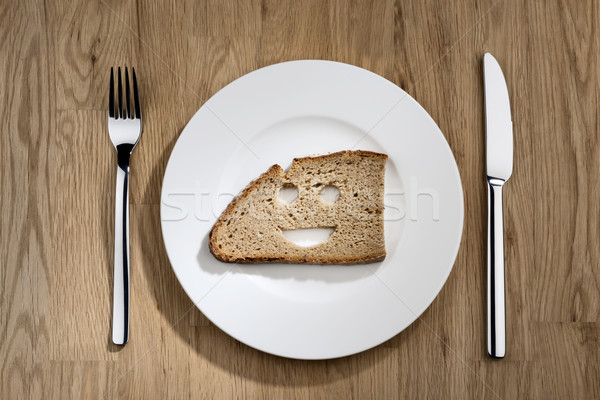 Ekmek güler yüz beyaz plaka görüntü dilim Stok fotoğraf © w20er