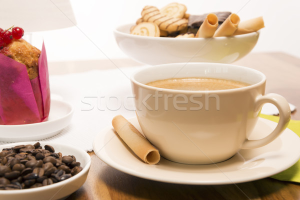 Cup of coffee with beans and muffin Stock photo © w20er