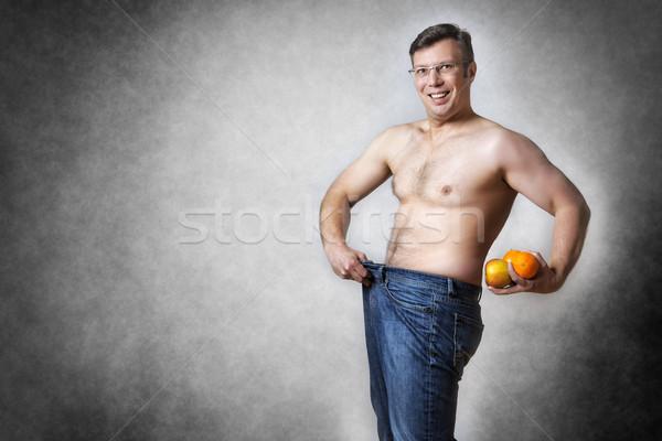Man vruchten verloren lichaam gewicht afbeelding Stockfoto © w20er