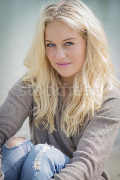 Blond woman sitting at lake Stock photo © w20er