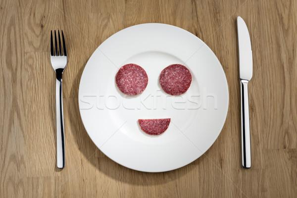 Glimlachend salami plaat afbeelding lachend gezicht Stockfoto © w20er