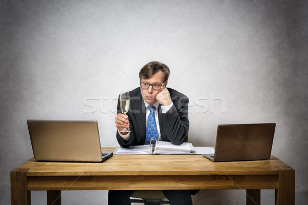 Lonely business man with champagne glass Stock photo © w20er