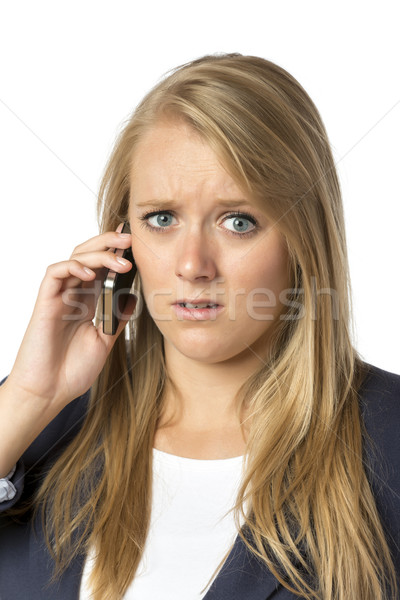 Blond phoning serious woman Stock photo © w20er