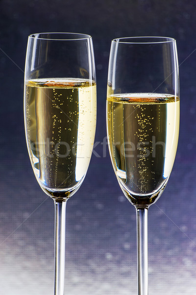 Stock photo: Champagner with blue background