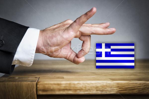 Man shoots Greek Flag off Stock photo © w20er