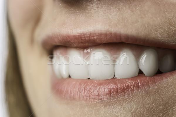 Closeup white teeth of young woman Stock photo © w20er