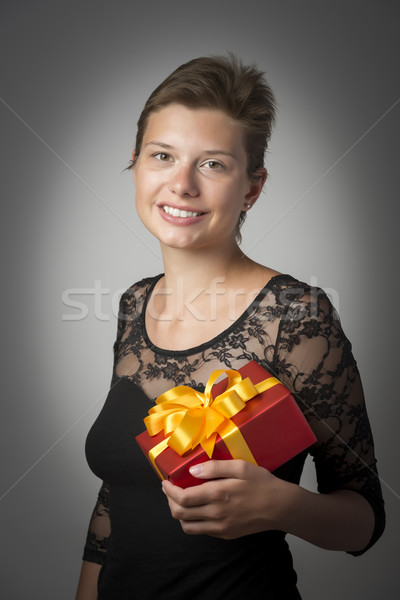 Woman in gown with present Stock photo © w20er