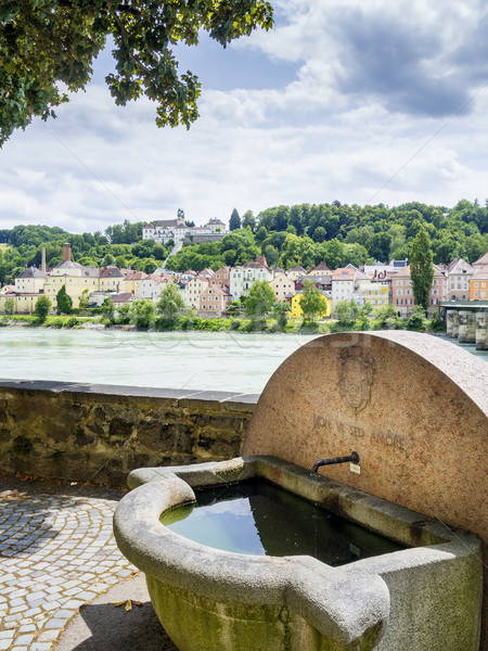 Well and riverside in Passau Stock photo © w20er