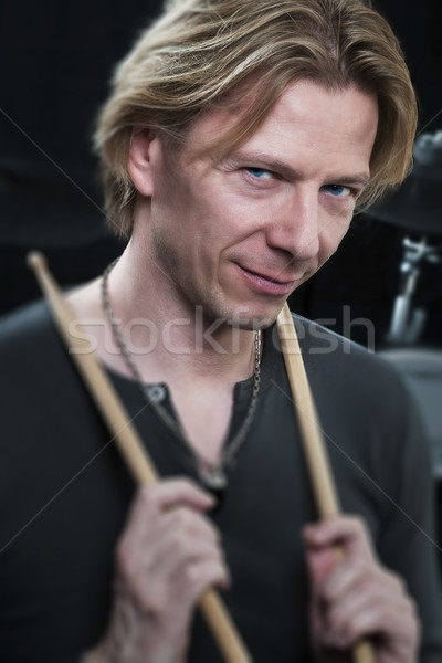 Man with drum sticks is looking to the viewer Stock photo © w20er