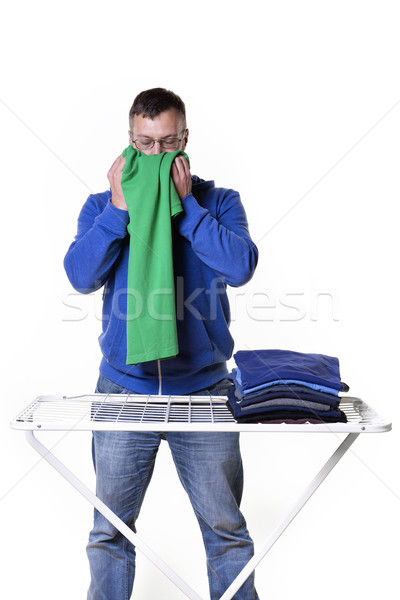 man smells laundry Stock photo © w20er