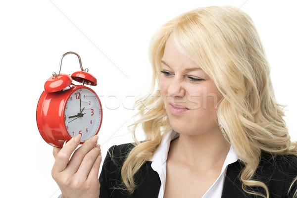 Boldogtalan szőke nő nevet piros ébresztőóra Stock fotó © w20er