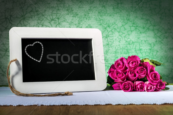 slate blackboard with heart and roses Stock photo © w20er
