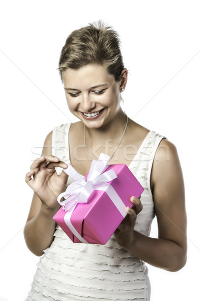Young pretty woman unwraps gift Stock photo © w20er
