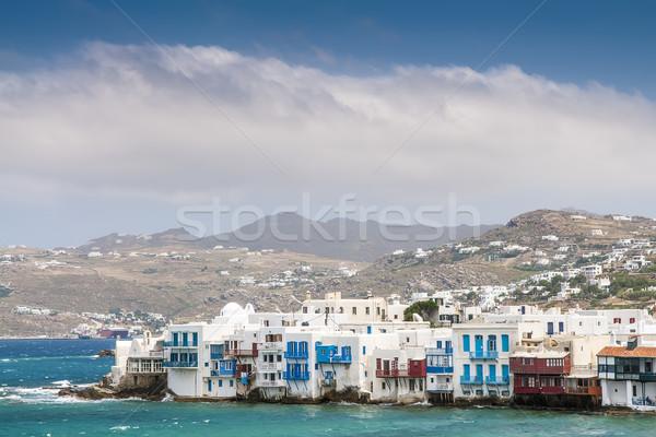 Házak sziget fehér hegyek tenger napos Stock fotó © w20er