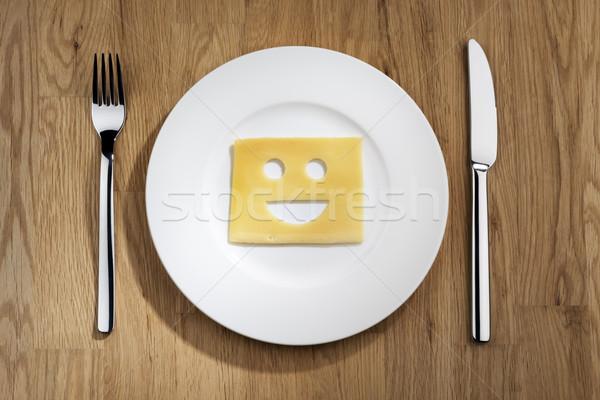 Ser uśmiechnięta twarz tabeli obraz plaster biały Zdjęcia stock © w20er