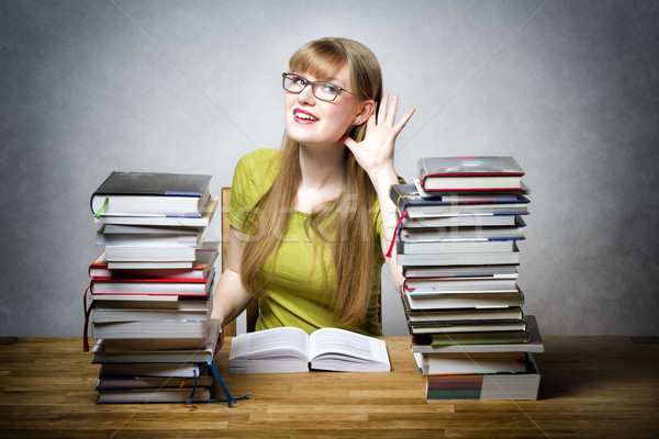 Listening female student with books Stock photo © w20er